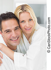 Closeup portrait of a woman embracing man