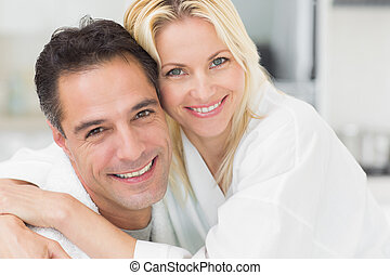 Closeup portrait of a woman embracing man