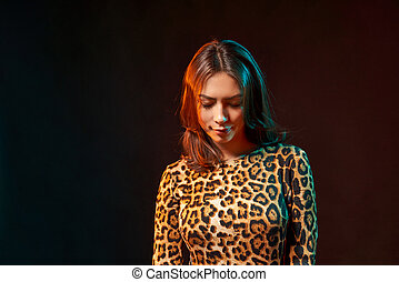 Closeup portrait of a woman in leopard print clothing