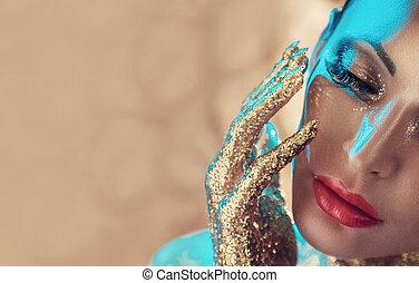 Closeup portrait of a woman with golden hands