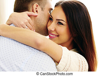 Closeup portrait of a young beautiful couple hugging