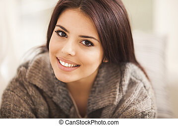 Closeup portrait of a young beautiful lady looking at camera