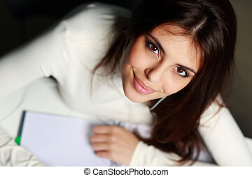 Closeup portrait of a young beautiful happy student