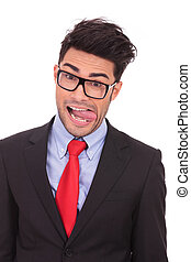 closeup portrait of a young business man making a fool out of himself, sticking his tongue out, on a white background