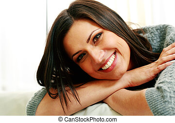 Closeup portrait of a young cheerful woman
