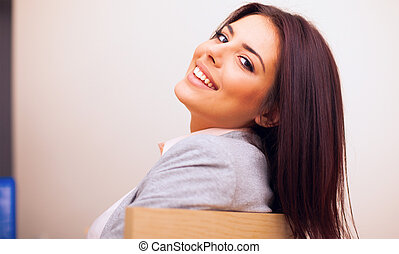 Closeup portrait of a Young confident smiling woman