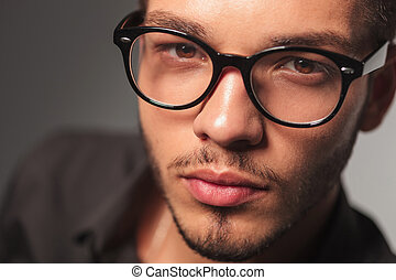 closeup portrait of a young cute man with glasses