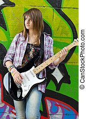 Closeup portrait of a young girl with guitar