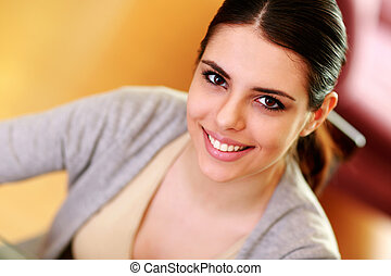 Closeup portrait of a young happy woman at home