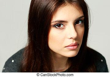 Closeup portrait of a young pensive woman