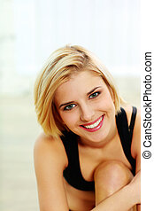 Closeup portrait of a young smiling fit woman
