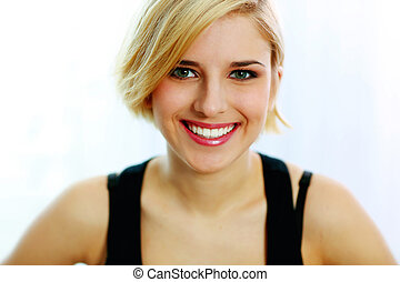 Closeup portrait of a young smiling woman isolated on a white background