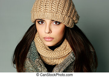 Closeup portrait of a young thoughtful woman in warm winter...