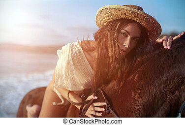 Closeup portrait of a young woman riding a majestick horse