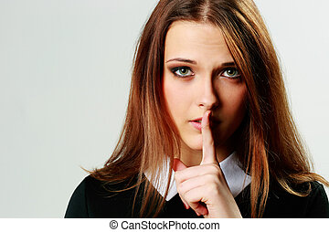 Closeup portrait of a young woman with silence sign isolated...