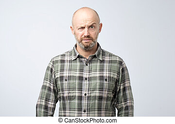 Closeup portrait of angry mature man, about to have nervous breakdown, isolated on gray wall background.
