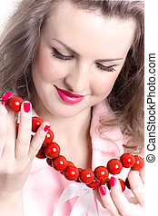 woman with red beads