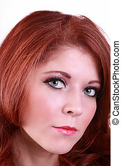 Closeup portrait of attractive redhead young woman