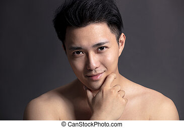 Closeup portrait of attractive young asian man face