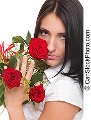 Closeup portrait of attractive young woman holding a red rose
