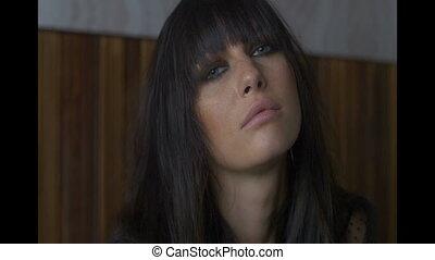 Closeup portrait of beautiful brunette woman posing and...