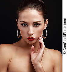 Closeup portrait of beautiful female perfect makeup face looking