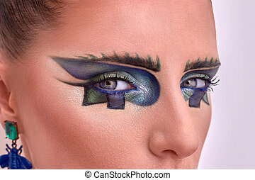 Closeup portrait of beautiful model. Fashion style, geometry makeup.
