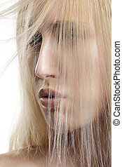 closeup portrait of beautiful model with blond hair covering her face