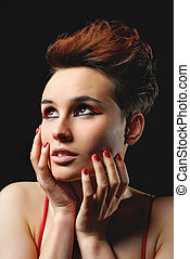 Closeup portrait of beautiful woman with bright make-up and red nails