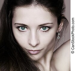 Closeup portrait of beautiful woman with sexy green eyes looking. Fashion portrait of young passion model