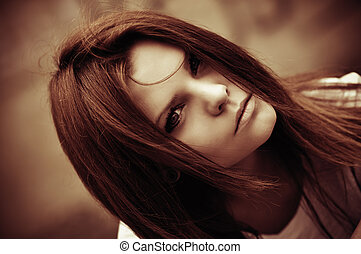 Closeup portrait of beautiful young girl. In faded tones -...