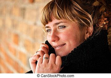 Closeup portrait of beautiful young woman smiling - Outdoor