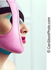 closeup portrait of beautiful young woman with creative makeup