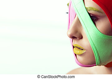 closeup portrait of beautiful young woman with creative makeup