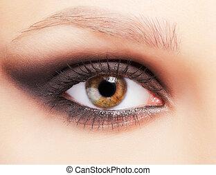 closeup portrait of beautiful young woman's eye zone make up