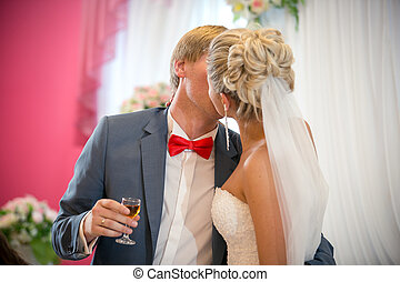 portrait of bride and groom kissing at restaurant