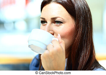 Closeup portrait of businesswoman drinking coffee in office cafe