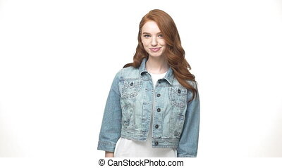 Closeup portrait of casual teen girl in denim concentrated...