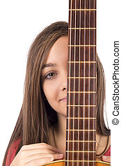 Closeup portrait of caucasian teenage girl with guitar