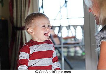 Closeup portrait of cheerful little boy smiling