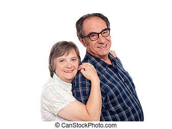 Closeup portrait of cheerful senior couple