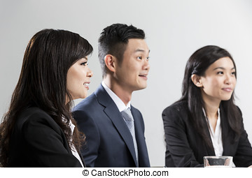 Closeup portrait of Chinese Business people having a meeting