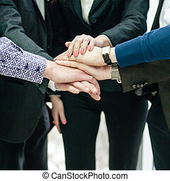 Closeup portrait of group of business people with hands...