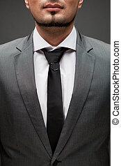 closeup portrait of handsome businessman on black