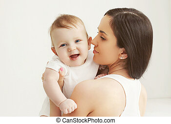 Closeup portrait of happy baby with mother at home
