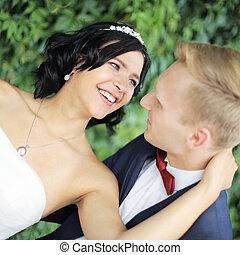 closeup. portrait of happy bride and groom