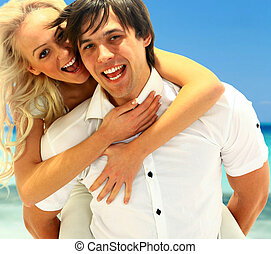 Closeup portrait of happy couple enjoying vacations on the...