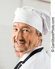 Closeup Portrait Of Happy Male Chef