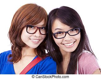 Closeup portrait of happy young girls