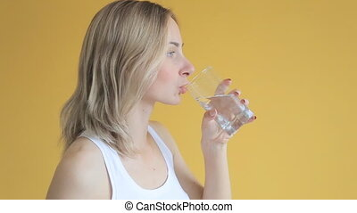 Closeup portrait of healthy young woman smiling drinking...